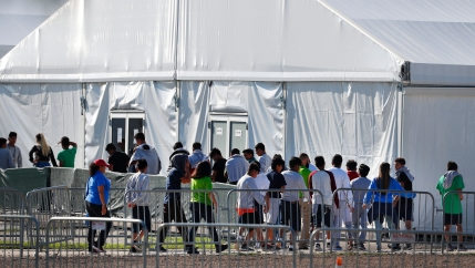 Children line up to enter a a temporary shelter in Florida, Feb. 2019.
