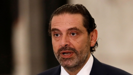 Lebanese Prime Minister-Designate Saad Hariri is show with his hair slicked back and wearing a dark suit.