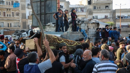 People attend funeral of fighters killed in an airstrike in the town of Idlib, Syria, Oct. 26, 2020.