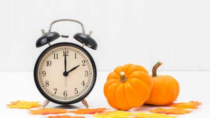 An alarm clock and a pumpkin