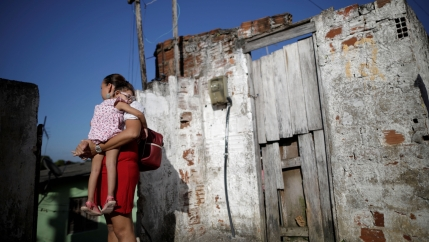 Gleyse Kelly da Silva, 28, holds her 2-year-old daughter Maria Giovanna at their house in Recife, Brazil, Aug. 8, 2018.
