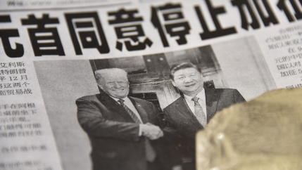 A Chinese newspaper displays an image of friendly presidents Donald Trump and Xi Jinping.
