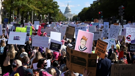 Women's March activists participate in a nationwide protest against US President Donald Trump's decision to fill the seat on the Supreme Court left by the passing of late Justice Ruth Bader Ginsburg before the 2020 election, in Washington, Oct. 17, 2020.