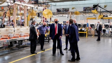 US President Donald Trump wears a protective face mask due to the coronavirus disease (COVID-19) pandemic as he tours the assembly line at a Whirlpool Corporation washing machine factory in Clyde, Ohio, Aug. 6, 2020.