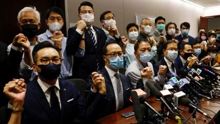 Pro-democratic legislators including Wu Chi-Wai, Claudia Mo and Lam Cheuk-ting announced plans to resign from the Legislative Council in Hong Kong, Nov. 11, 2020.