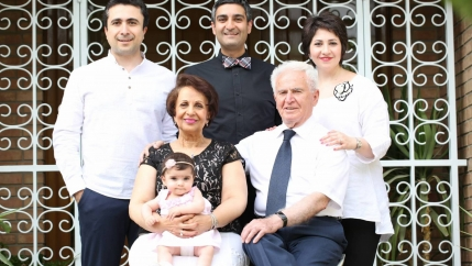 Armin Deroee, left, stands next to brother-in-law Mahyar and sister Ramina, while parents Ameneh and Ebrahim hold granddaughter Niki, at their home in Tehran, Iran, Jan.2018.