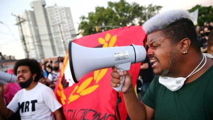 A demonstrator reacts during a protest against racism after João Alberto Silveira Freitas was beaten to death by security guards at a Carrefour supermarket in Porto Alegre, Brazil, Nov. 23, 2020.