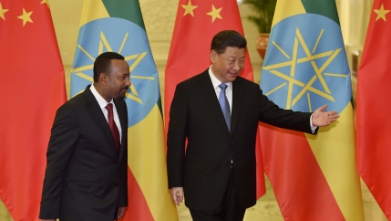 Ethiopia's Prime Minister Abiy Ahmed, left, is shown the way by Chinese President Xi Jinping before their meeting at the Great Hall of the People in Beijing,China, April 24, 2019.