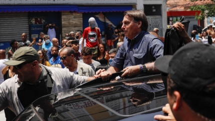 Brazil's President Jair Bolsonaro leaves after he voted during the municipal elections in Rio de Janeiro,Nov.15, 2020.