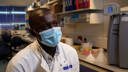 KEMRI's principal investigator, George Warimwe, for the Oxford AstraZeneca COVID-19 vaccine trial is shown at the KEMRI Wellcome Trust lab in Kilifi, Kenya, on Nov. 13, 2020.