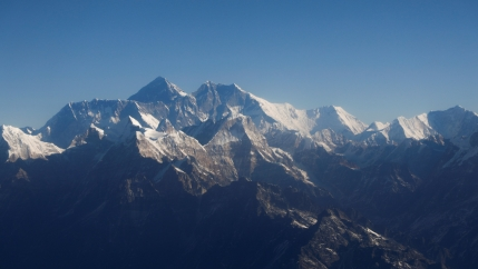 Mount Everest, the world highest peak, and other peaks of the Himalayan range are seen through an aircraft window during a mountain flight from Kathmandu, Nepal, Jan. 15, 2020.