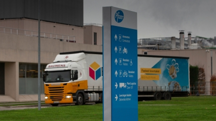 A truck leaves Pfizer Manufacturing in Puurs, Belgium, Dec. 2, 2020.