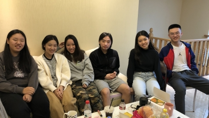 Emily Mao, second from left, joined a co-living community of students in Hangzhou, China, who are studying online — often overnight — at US and Canada-based colleges and universities.