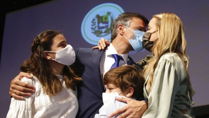 Venezuelan opposition leader Leopoldo López kisses his wife Lilian Tintori with their son and daughter after a news conference in Madrid on Oct. 27, 2020. López who has abandoned the Spanish ambassador's residence in Caracas and left Venezuela after years
