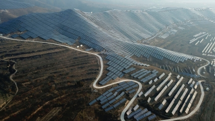 In this Nov. 28, 2019, photo, a solar panel installation is seen in Ruicheng County in central China's Shanxi Province.