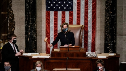Speaker of the House Nancy Pelosi gavels in the final vote of the impeachment of President Donald Trump