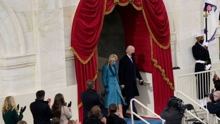 President-elect Joe Biden and his wife Jill are shown walking down the steps of the US Captiol building.