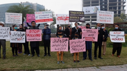 Supporters of a civil society organization hold a demonstration to protest against the killing of coal mine workers by gunmen near the Machh coal field, in Lahore, Pakistan, Jan. 8, 2021. Pakistan's prime minister Friday appealed to the protesting minorit