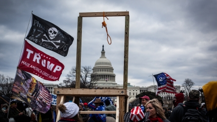 Crowds carrying hate symbols as they stormed the U.S Capitol on Jan. 6 in Washington, D.C.