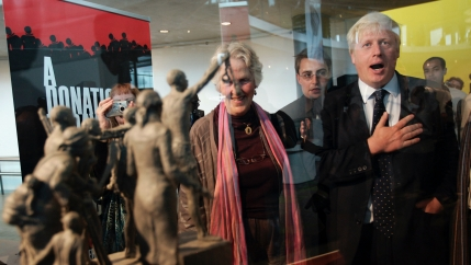 Former mayor of London Boris Johnson, right, is seen by a maquette of a statue that stands as a permanent slavery memorial statue at City Hall in London, Aug. 18, 2008.