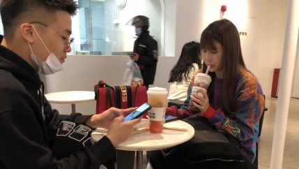 Two people enjoy bubble tea.