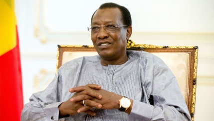 Chadian President Idriss Déby Itno is shown seated and with his hands folded.