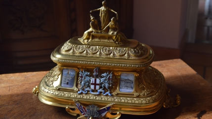 "Up-close photo of the golden chest featured in the treasure hunt, ""The Golden Treasure of the Entente Cordiale."