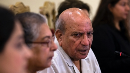 IA Rehman, center, an official from the Human Rights Commission addresses a news conference, in Islamabad, Pakistan, July 16, 2018. Rehman, an iconic Pakistani human rights defender and former editor, has died in the eastern city of Lahore after a brief i