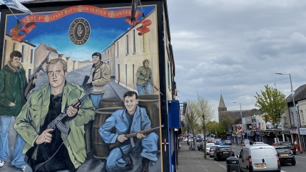 Areas of west Belfast are dominated by vivid murals depicting armed Loyalist and Republican paramilitary figures.