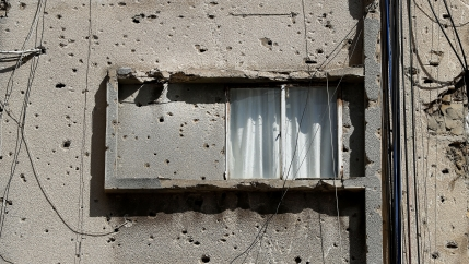 A building is still riddled with war damage, on the former frontline of the Lebanese Civil War, in Beirut, Lebanon, Tuesday, April 13, 2021.