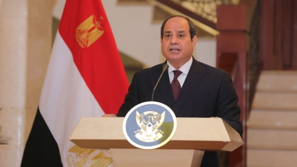 President Abdul Fattah al-Sisi at a podium with an Egyptian flag behind him