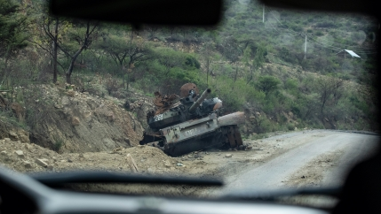 A destroyed tank sits by the side of a road leading to Abi Adi, in the Tigray region of northern Ethiopia, May 11, 2021.