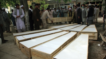 The coffins of the victims in Tuesday's attack are placed on the ground at a hospital in northern Baghlan province, Afghanistan,June 9, 2021.