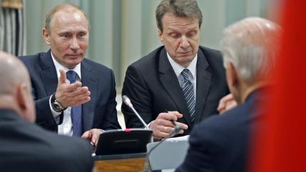 President Putin sits across from President Biden.