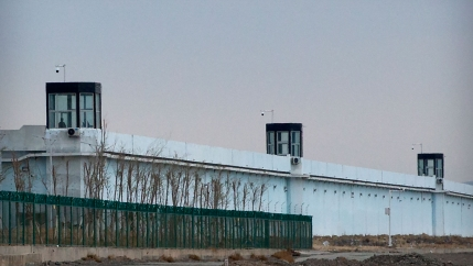 A person stands in a tower on the perimeter of the Number 3 Detention Center in Dabancheng in western China's Xinjiang Uyghur Autonomous Region on April 23, 2021.