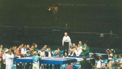 George Nissen appears on a trampoline at the 2000 Olympics.