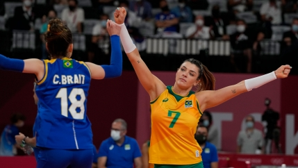 Brazil's libero Camila Brait and teammate Rosamaria Montibeller fist bump during a women's volleyball semifinal match against South Korea, at the 2020 Summer Olympics, Friday, Aug. 6, 2021, in Tokyo, Japan.