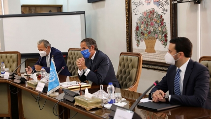 Rafael Mariano Grossi, director-general of International Atomic Energy Agency, IAEA, center, attends a meeting with the Head of Atomic Energy Organization of Iran, Mohammad Eslami, in Tehran, Iran, Sunday, Sept. 12, 2021.