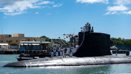 In this photo provided by US Navy, the Virginia-class fast-attack submarine USS Illinois (SSN 786) returns home to Joint Base Pearl Harbor-Hickam from a deployment in the 7th Fleet area of responsibility