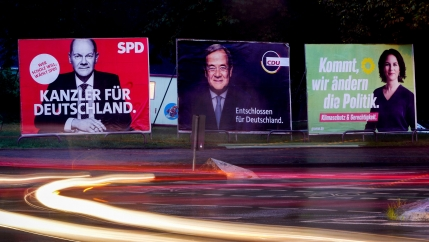 Three elections posters show Social Democratic top candidate for chancellor Olaf Scholz, left, Christian Democratic top candidate Armin Laschet, center, and top candidate of the Greens Annalena Baerbock in Frankfurt, Germany, Wednesday, Sept. 15, 2021.
