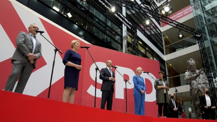 Olaf Scholz, center, top candidate for chancellor of the Social Democratic Party (SPD), speaks during a press conference at the party's headquarters in Berlin, Germany