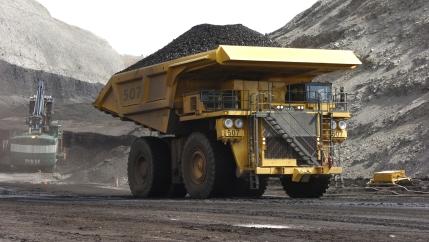 In this April 4, 2013, file photo, a mining dumper truck hauls coal at Cloud Peak Energy's Spring Creek strip mine near Decker, Montana.