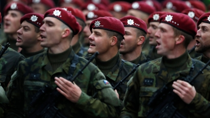 Soldiers march during a military parade marking 100th anniversary of the 1918 creation of the Czechoslovak state in Prague, Czech Republic, Sunday, Oct. 28, 2018.