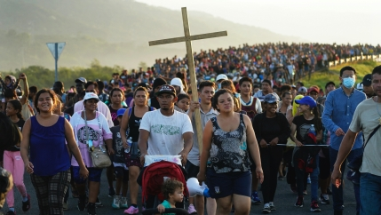 Migrants leave Huixtla, Chiapas state, Mexico, early Oct. 27, 2021, as they continue their trek north toward Mexico's northern states and the USborder.