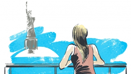 A woman is leaning on a fence, gazing over the water toward the Statue of Liberty
