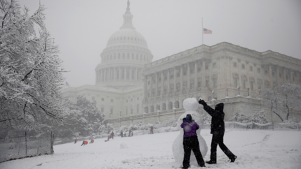 People build a snowman outside the US Capitol in Washington, D.C., March 21, 2018.
