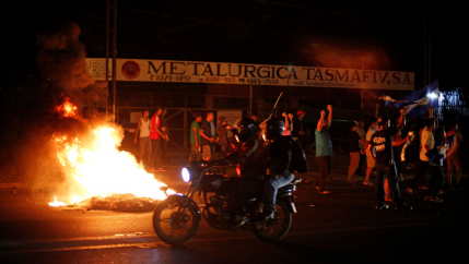 Demonstrators shout next to a burning barricade as they take part in a protest over a controversial reform to the pension plans of the Nicaraguan Social Security Institute (INSS) in Managua, Nicaragua April 21, 2018.