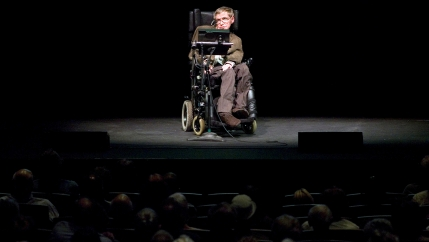 Stephen Hawking onstage discussing theories on the origin of the universe in a talk in Berkeley, California, 2007.