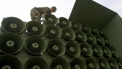 A South Korean soldier works on a stack of loudspeakers used for propaganda purposes near the demiltarized zone.