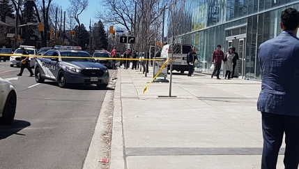 Police officers arrest suspect driver after a van hit multiple people at a major intersection in Toronto, Canada April 23, 2018, in this picture obtained from social media.